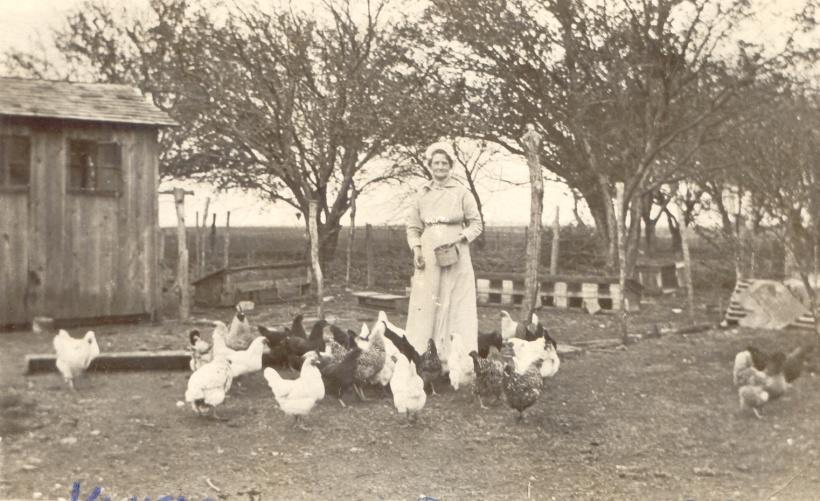 Margaret (Maggie) Dugan with chickens1909 Kansas