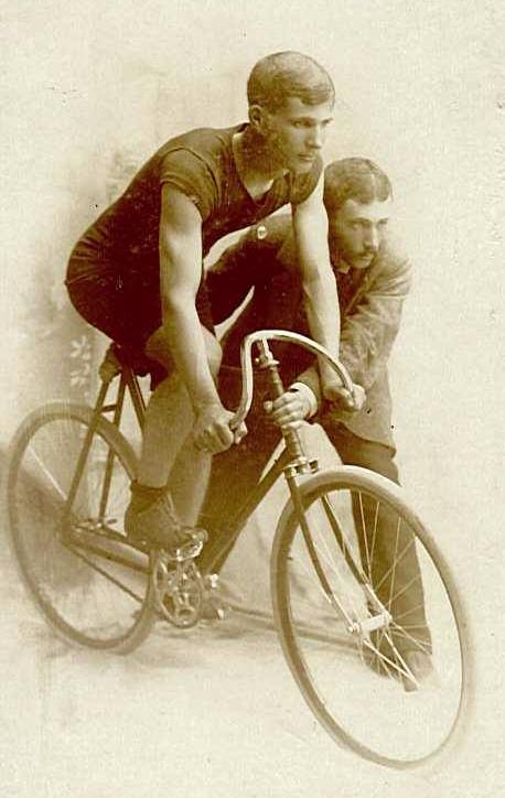 Paul Smith on bike with Clark S. Smith